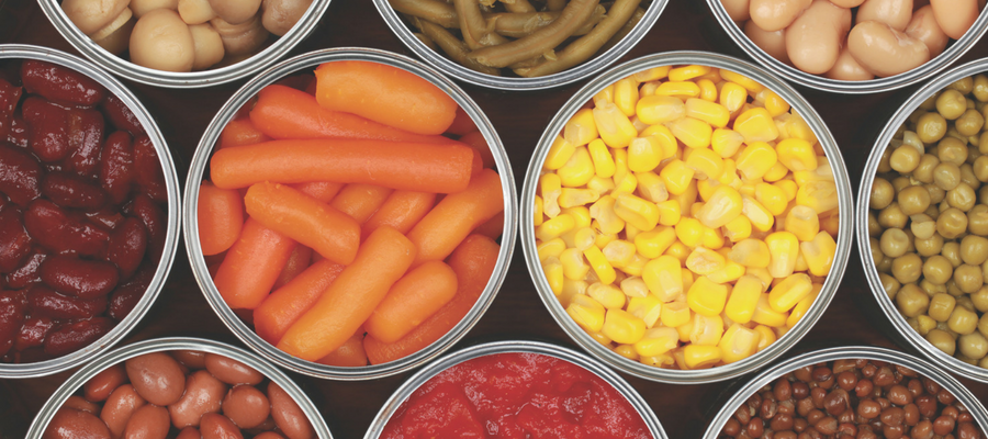 Carrots, corn, beans, and other food in jars